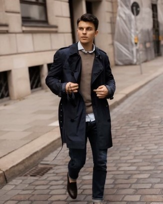 Dark Brown Leather Loafers Outfits For Men: If you don't take fashion lightly, go for sophisticated style in a navy trenchcoat and navy jeans. To introduce a little fanciness to this ensemble, complement this look with a pair of dark brown leather loafers.