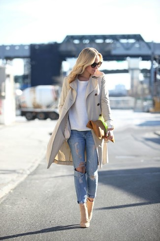 A white crew-neck pullover and light blue ripped skinny jeans are a great outfit formula to have in your arsenal. A pair of nude suede ankle boots will seamlessly integrate within a variety of outfits.