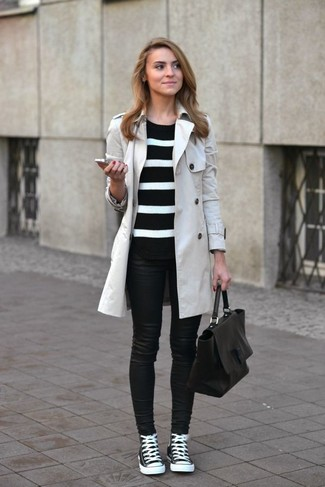 A nicely put together combination of a grey trench and black leather skinny jeans will set you apart effortlessly. For footwear go down the casual route with black and white high top sneakers.