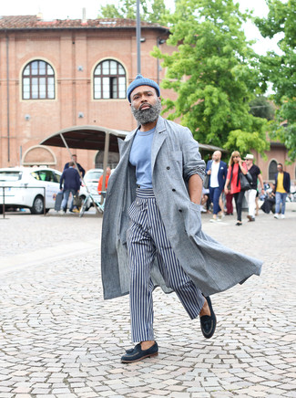 How to wear: grey linen trenchcoat, light blue crew-neck t-shirt, grey vertical striped chinos, navy leather tassel loafers