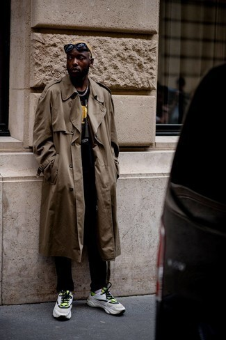 Men's Outfits 2021: As you can see, it doesn't require that much effort for a man to look on-trend. Just opt for a brown trenchcoat and black chinos and be sure you'll look amazing. Why not complement your getup with a pair of white and green athletic shoes for a hint of stylish nonchalance?