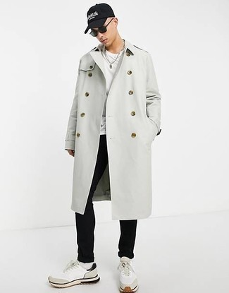 Grey Trenchcoat Outfits For Men: Elevate your sartorial game to new heights by teaming a grey trenchcoat and black chinos. Go off the beaten path and spice up your outfit by finishing with a pair of white athletic shoes.