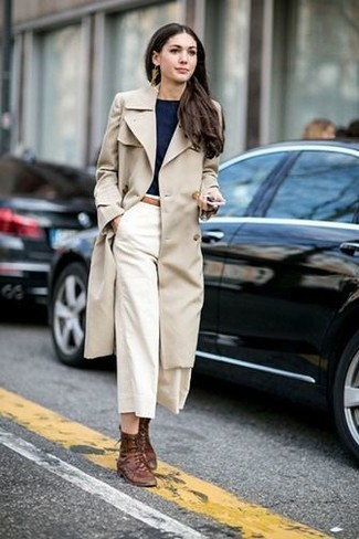 How to wear: beige trenchcoat, black crew-neck t-shirt, white culottes, brown leather lace-up flat boots