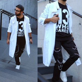 A trench and black ripped jeans are a great outfit formula to have in your arsenal. If you don't want to go all out formal, go for a pair of white low top sneakers.