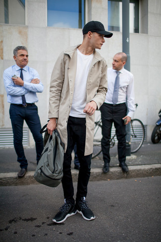 How to wear: beige trenchcoat, white crew-neck t-shirt, black skinny jeans, black athletic shoes