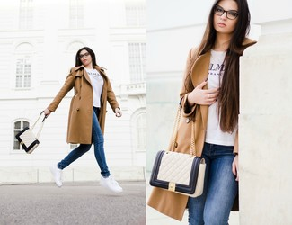 Women's Tan Trenchcoat, White and Black Print Crew-neck T-shirt, Blue Skinny Jeans, White Leather Low Top Sneakers