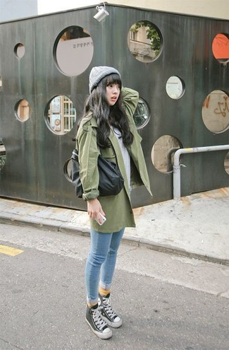 How to wear: green trenchcoat, grey crew-neck t-shirt, light blue skinny jeans, black and white high top sneakers