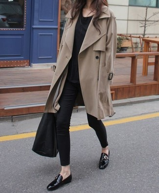 How to wear: tan trenchcoat, black crew-neck t-shirt, black skinny pants, black leather double monks