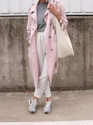 A rose pink trench coat and white tapered pants are appropriate for both smart casual events and day-to-day wear. Make your look more fun by completing it with grey athletic shoes. Loving this one, especially for the spring season.