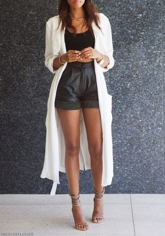 How to wear: white lightweight trenchcoat, black cropped top, black leather shorts, beige leather heeled sandals