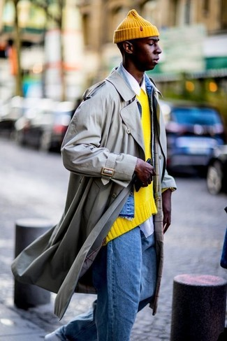 How to wear: beige trenchcoat, blue denim jacket, yellow crew-neck sweater, white long sleeve shirt