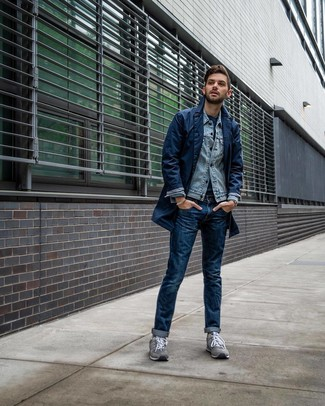 How to wear: navy trenchcoat, light blue denim jacket, navy crew-neck t-shirt, navy jeans