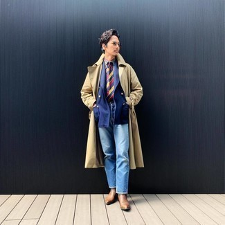 How to Wear a Tan Trenchcoat For Men: A tan trenchcoat and light blue jeans make for the perfect base for an outfit. Add brown leather chelsea boots to the mix for an instant style boost.