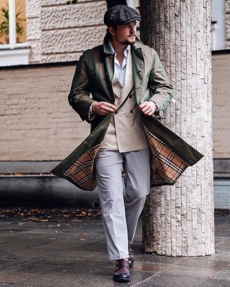 Flat Cap Outfits For Men: For a tested off-duty option, you can rely on this pairing of an olive trenchcoat and a flat cap. For something more on the classier end to finish off this look, introduce dark brown leather double monks to the mix.