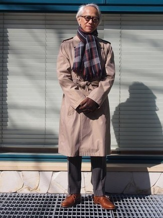 Trenchcoat Outfits For Men: Wear a trenchcoat and charcoal vertical striped dress pants for an incredibly sharp outfit. This outfit is completed wonderfully with a pair of brown leather derby shoes.