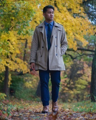 Brogue Boots Outfits: Marry a grey trenchcoat with navy chinos and you'll achieve a sleek and sophisticated look. Complement your look with brogue boots and ta-da: your getup is complete.