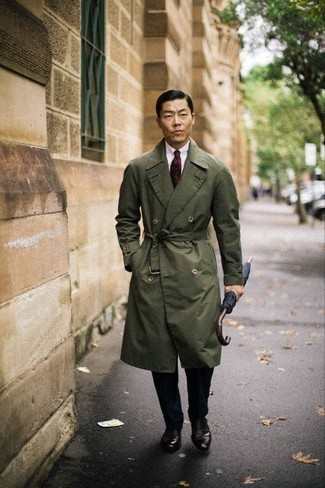 Bow-tie Outfits For Men: Why not consider pairing an olive trenchcoat with a bow-tie? These two pieces are very practical and will look cool when matched together. Take this outfit down a classier path by sporting dark brown leather oxford shoes.