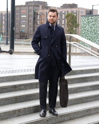 Bag Outfits For Men: Consider wearing a navy trenchcoat and a bag for a contemporary and trendy look. Clueless about how to round off your getup? Round off with a pair of black leather loafers to dial up the wow factor.
