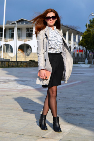 Go for a classic style in a grey trenchcoat and a black pencil skirt. Round off this look with black leather ankle boots.