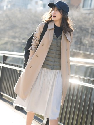 For a smart casual getup, consider pairing a tan trench coat with a black canvas rucksack — these pieces fit really well together. These picks will keep you cozy and stylish in summer-to-fall weather.