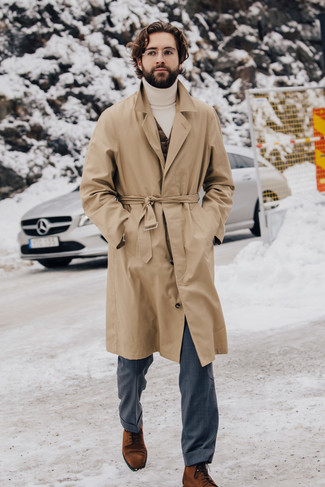 How to Wear a Tan Trenchcoat For Men: You'll be surprised at how easy it is to put together this sophisticated ensemble. Just a tan trenchcoat and grey dress pants. As for shoes, complement this ensemble with a pair of tobacco suede dress boots.