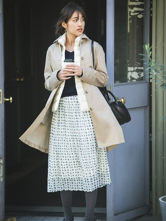 Wear a gilet with a white and black check full skirt for an easy to wear look. You can bet this combo is the answer to all of your fall dressing struggles.