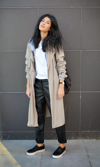Effortlessly blurring the line between chic and casual, this combination of a grey trenchcoat and black leather pajama pants is likely to become one of your favorites. A pair of black leather slip-on sneakers brings the dressed-down touch to the ensemble.