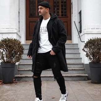 White and Black Print Crew-neck T-shirt Outfits For Men: Choose a white and black print crew-neck t-shirt and black ripped skinny jeans if you're looking for an outfit idea that conveys casual cool. Finish with a pair of white athletic shoes et voila, the look is complete.