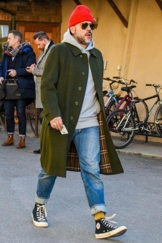 How to Wear a Red Beanie For Men: Consider pairing a dark green trenchcoat with a red beanie to achieve a laid-back and absolutely dapper ensemble. Add a pair of navy and white canvas high top sneakers to this ensemble and off you go looking amazing.
