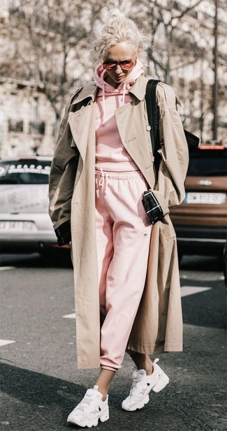 How to wear: beige trenchcoat, pink hoodie, pink sweatpants, white athletic shoes