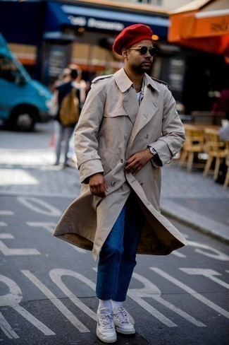 White Leather Low Top Sneakers Outfits For Men: This combination of a beige trenchcoat and navy jeans might pack a punch, but it's very easy to recreate. For something more on the relaxed end to finish your getup, complement your getup with a pair of white leather low top sneakers.