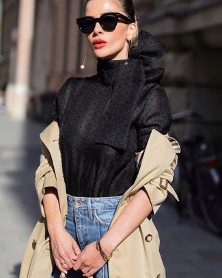 How to wear: tan trenchcoat, black long sleeve blouse, blue jeans, black sunglasses