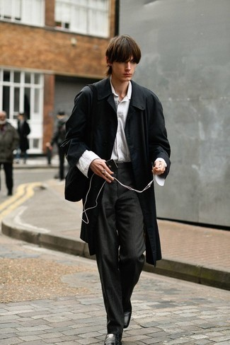 Black Leather Chelsea Boots Outfits For Men: This pairing of a black trenchcoat and charcoal vertical striped chinos couldn't possibly come across as anything other than devastatingly dapper and effortlessly sleek. If you need to immediately rev up this outfit with a pair of shoes, complement your ensemble with a pair of black leather chelsea boots.