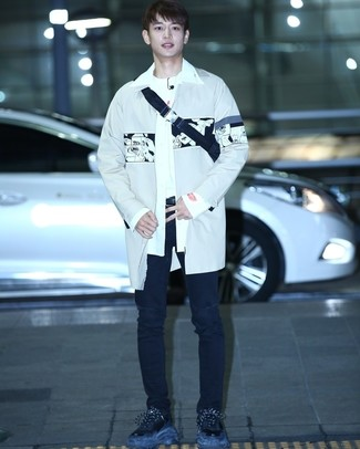 How to wear: grey trenchcoat, white long sleeve shirt, white crew-neck t-shirt, black ripped jeans