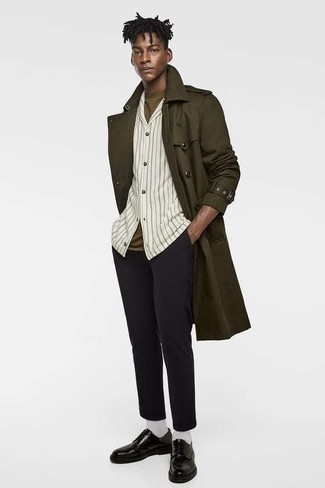 How to wear: olive trenchcoat, beige vertical striped long sleeve shirt, olive crew-neck t-shirt, black wool chinos