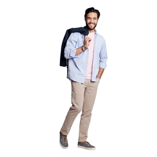 How to wear: navy trenchcoat, light blue long sleeve shirt, pink crew-neck t-shirt, beige chinos