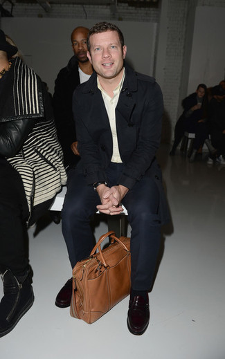 Dermot O'Leary wearing Black Trenchcoat, Beige Long Sleeve Shirt, Black Dress Pants, Burgundy Leather Loafers