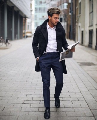 How to Wear a Black Trenchcoat For Men: A black trenchcoat looks so classy when matched with navy vertical striped dress pants in a modern man's combo. If you're wondering how to round off, a pair of black leather double monks is a winning option.