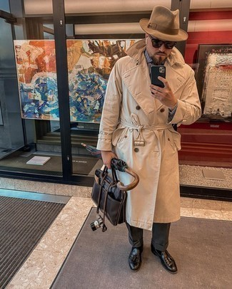 Men's Outfits 2021: A beige trenchcoat looks so refined when married with charcoal dress pants in a modern man's look. A pair of black leather tassel loafers easily turns up the cool of your look.
