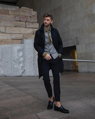 Black Leather Loafers Outfits For Men: For something on the smart casual side, try pairing a navy trenchcoat with navy chinos. Go ahead and complement this look with a pair of black leather loafers for an extra dose of refinement.