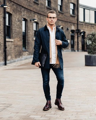 How to wear: navy trenchcoat, white long sleeve shirt, navy skinny jeans, burgundy leather brogues