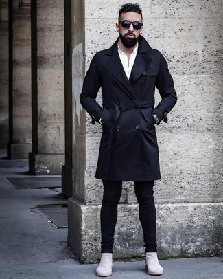 Silver Chelsea Boots Outfits For Men: Extremely dapper, this casual pairing of a navy trenchcoat and black skinny jeans provides with variety. Jazz up your outfit with a more refined kind of footwear, like this pair of silver chelsea boots.