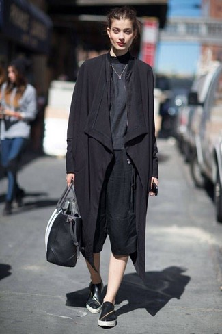 Master the effortlessly chic look in a black trenchcoat and black culottes. For a more relaxed take, choose a pair of black leather slip-on sneakers.