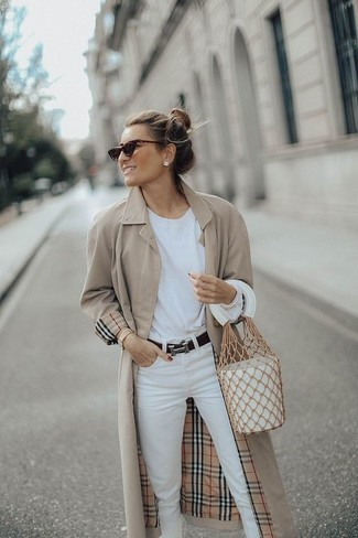 How to wear: beige trenchcoat, white long sleeve t-shirt, white jeans, white leather bucket bag