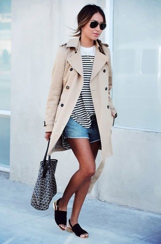 Wear a beige trenchcoat with blue denim shorts to create a chic, glamorous look. Black suede flat sandals will add some edge to an otherwise classic look.