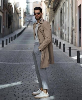 How to Wear a Tan Trenchcoat For Men: This combo of a tan trenchcoat and grey chinos is the ideal balance between elegant and casual. White canvas low top sneakers will add a more dressed-down aesthetic to the getup.