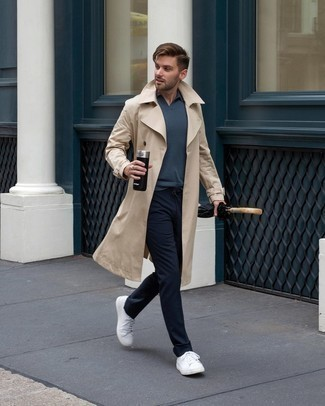 Beige Trenchcoat Outfits For Men: A beige trenchcoat and navy chinos are the perfect base for a classic and casual outfit. Send an otherwise mostly dressed-up getup down a sportier path with a pair of white canvas low top sneakers.