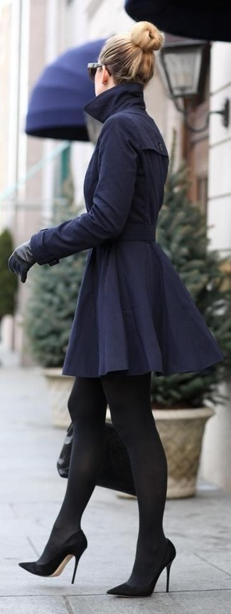Tap into refined, elegant style with a navy blue trenchcoat. This outfit is complemented perfectly with black suede pumps.
