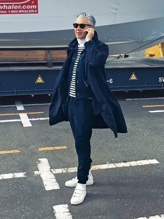 How to Wear Navy Sunglasses In Chill Weather For Men: You'll be amazed at how super easy it is for any gentleman to put together a casual street style look like this. Just a navy trenchcoat and navy sunglasses. Our favorite of a variety of ways to complement this look is white canvas low top sneakers.