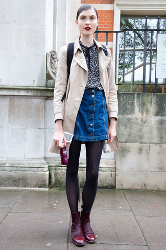 If you feel more confident wearing something comfortable, you'll love this absolutely chic pairing of a beige trench and a blue denim button skirt. Finish off this getup with oxblood suede booties. Seeing as it is getting chillier every day, this ensemble is a wonderful idea for the transitional season.